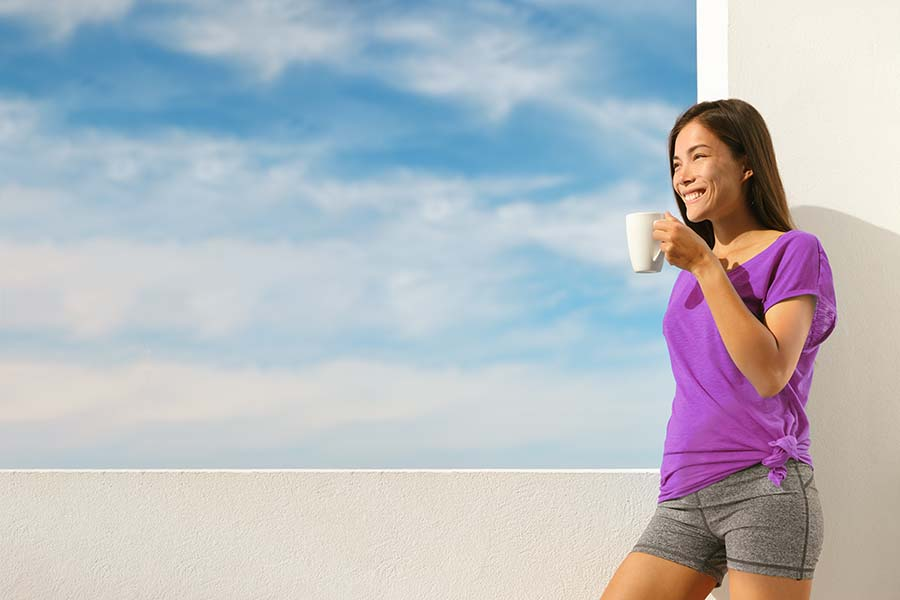 Woman enjoying TCM herbal drink after exercise