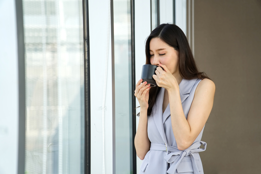 Woman drinking herbal tea brewed from traditional chinese medicine ingredients