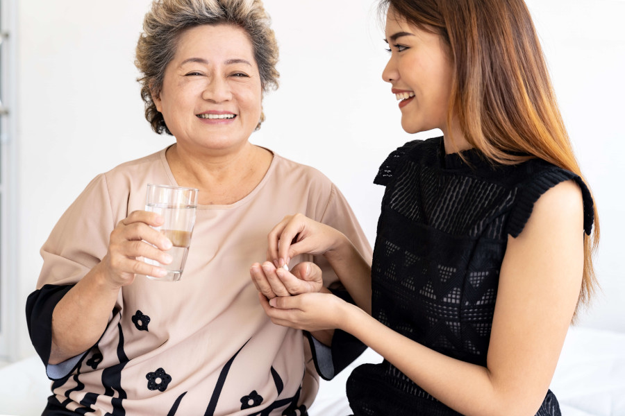 Senior lady taking chinese medicine for joint pain
