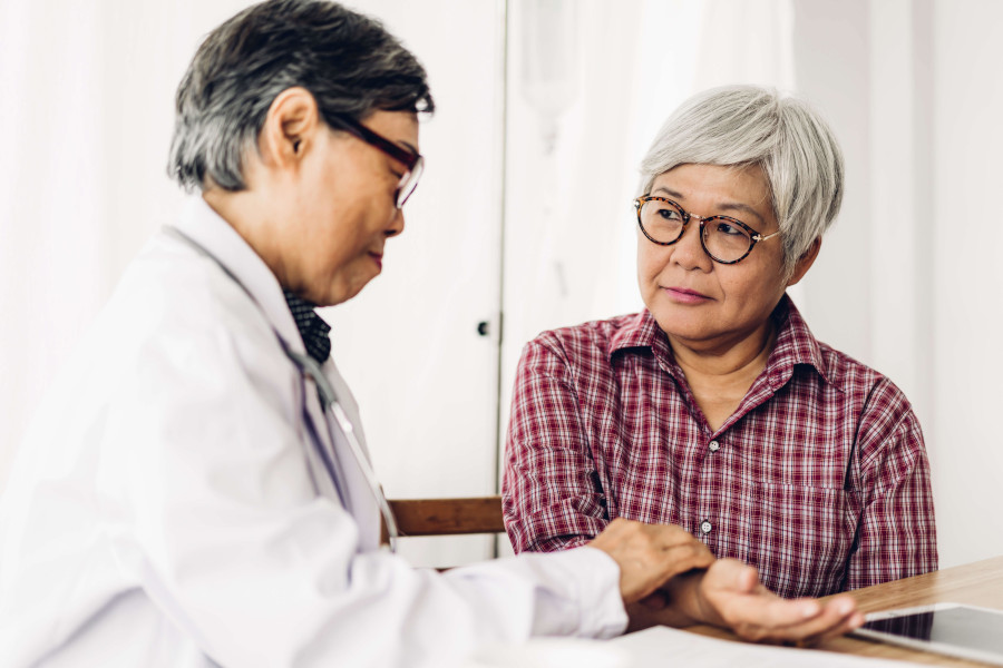 Traditional chinese medicine consultant with patient