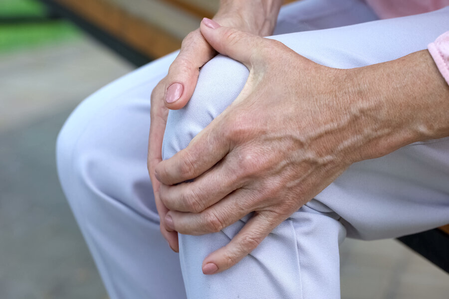 lady holding knee in pain