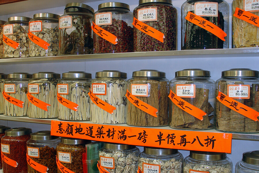 tcm herbs displayed on shelf